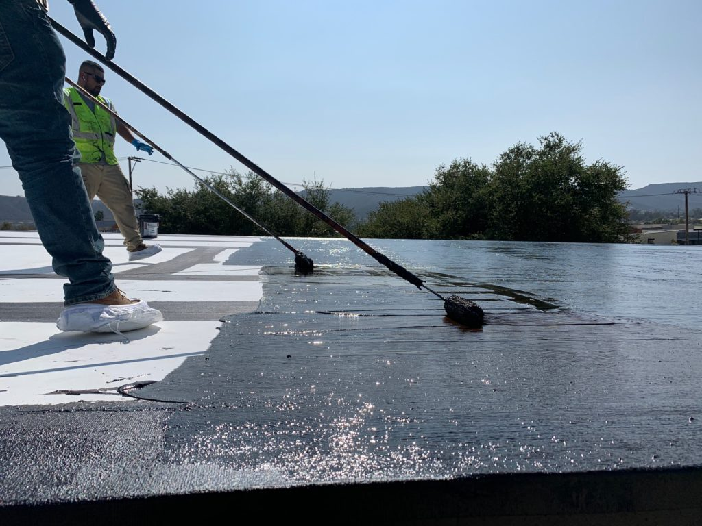 Roll-applying is slower, but it lays down a thicker surface on the roof, and no special equipment is needed.